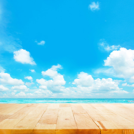 Wood table top on blue sea & sky background - beach & summer concepts Stock Photo