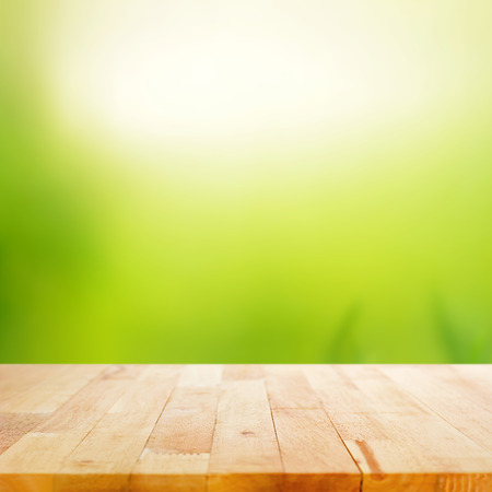 Wood table top on white green abstract background Stock Photo