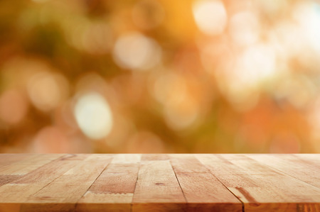 white table: Wood table top on brown bokeh abstract background