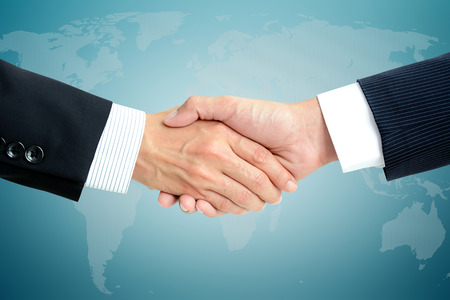 company merger: Handshake of businessmen - business partner, greeting & dealing concepts