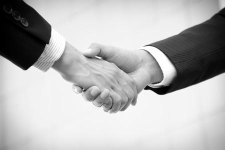 congratulate: Handshake of businessmen - monochrome effect Stock Photo