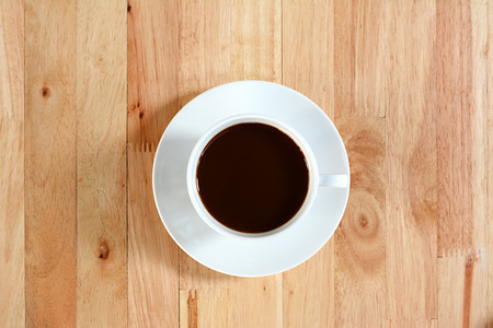 decaffeinated: Coffee cup on wood table