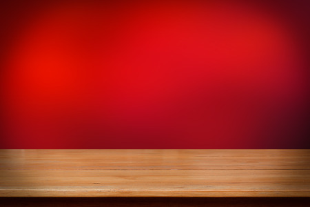 Wood table top on dark red abstract background