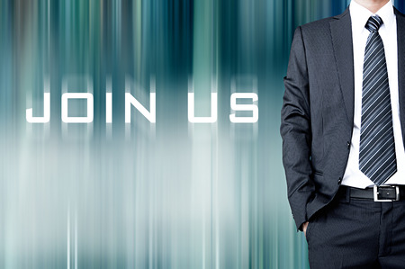partake: JOIN US sign on motion blur abstract background with standing businessman Stock Photo
