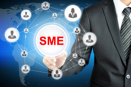 Businessman pointing on SME (Small & Medium Enterprise) sign on virtual screen with people icons linked as network Stock Photo - 36161478