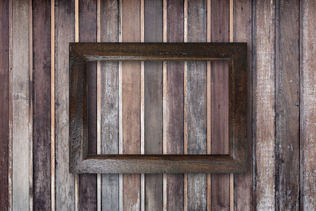 old wall: Picture frame on old wooden wall