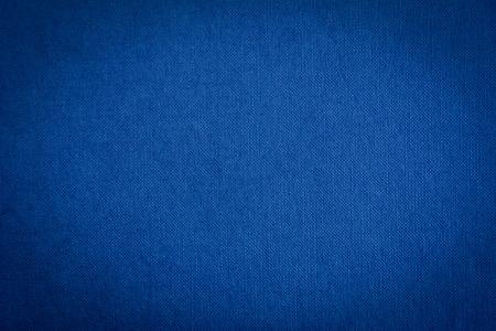 Oscuro textura de tela azul de fondo