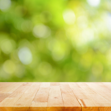 table top: Wood table top on green bokeh (or lens flare) background