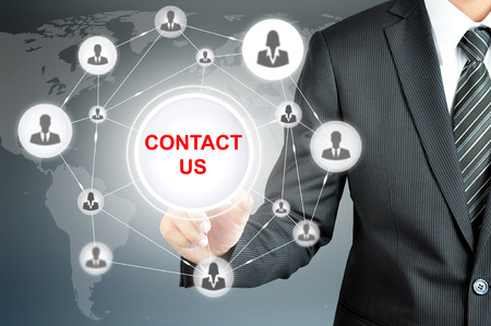 contact icons: Businessman pointing on CONTACT US sign on virtual screen with people icons linked as network