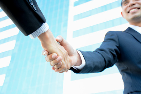 dealing: Handshake of businessmen with smiling face - greeting , dealing & partnership concepts