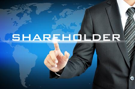 仮想画面上の株主の記号を指している実業家 写真素材