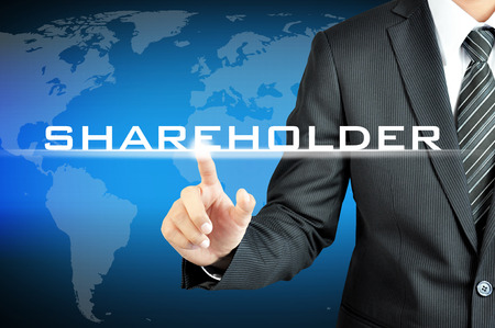 shareholders: Businessman pointing to SHAREHOLDERS sign on virtual screen