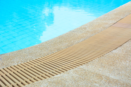 overflow: Swimming pool edge with drain Stock Photo