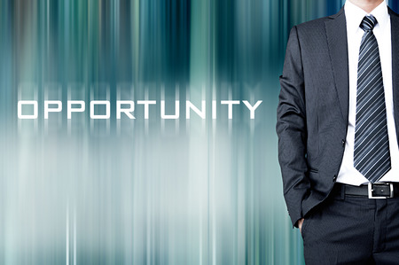 possibility: OPPORTUNITY sign on blur background with standing businessman