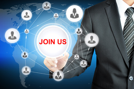 join hand: Businessman hand pointing on JOIN US sign on virtual screen with human icons linked as network