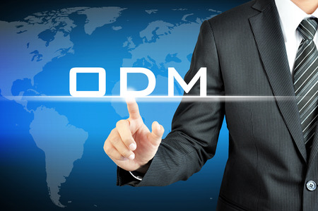 manufacturer: Businessman pointing on ODM (Original Design Manufacturer) sign on virtual screen Stock Photo