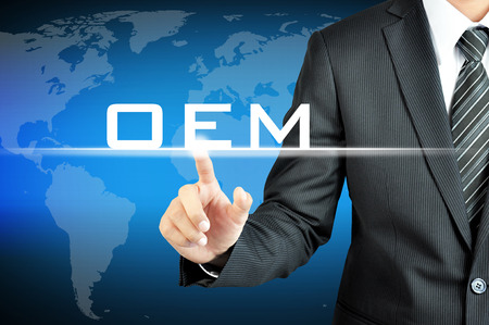 aftermarket: Businessman pointing on OEM (Original Equipment Manufacturer) sign on virtual screen Stock Photo