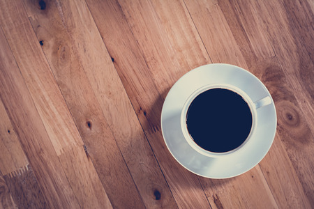 wooden table top view: Coffee cup on wooden table (top view) - vintage style effect