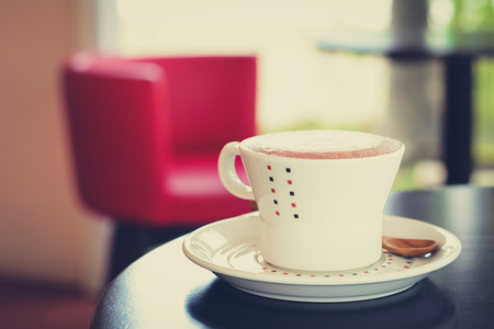 decaffeinated: Coffee cup on the table in coffee shop - vintage style effect Stock Photo