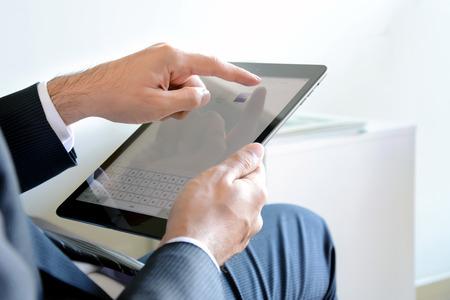 address bar: Businessman hands using ipad air, Apple tablet pc, touching on web browser address bar