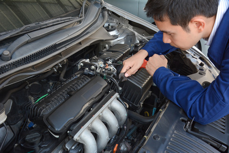 motor mechanic: Auto mechanic (or technician) fixing car engine Stock Photo