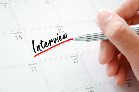 jot: Interview text on the calendar (or desk planner) underlined with red marker
