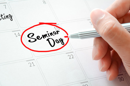 jot: Seminar Day texts on the calendar (or desk planner) circled with red marker