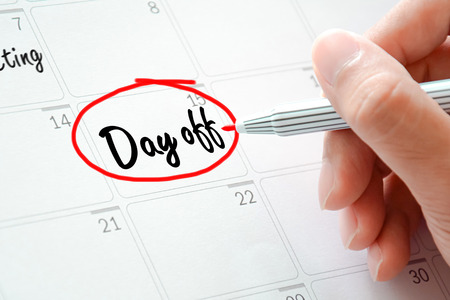 Day off text on the calendar ( or desk planner) circled with red marker