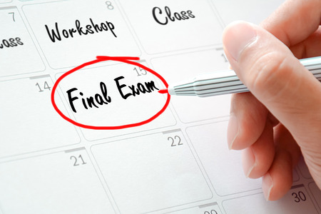final: Final Exam text on the calendar ( or desk planner) circled with red marker