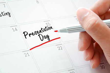 day planner: Presentation Day texts on the calendar (or desk planner) underlined with red marker