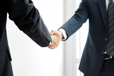 Handshake of businessmen - success, dealing, greeting & business partner concepts Фото со стока