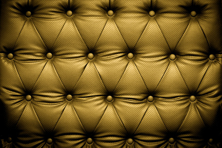 Luxury gold leather texture background with buttoned pattern photo