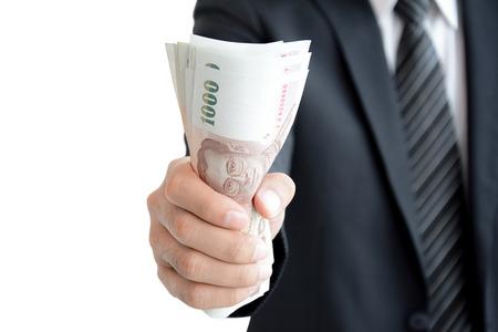 grabbing: Businessman hand grabbing money, Thai Baht (THB) - isolated on white background Stock Photo
