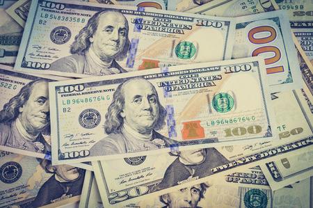 us dollar: Money - heap of US dollar bills in vintage (retro) style color effect