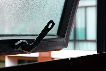 ajar: Open window with water drop on the glass - soft focus