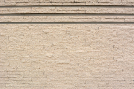 grooves: Sandstone brick wall texture as background