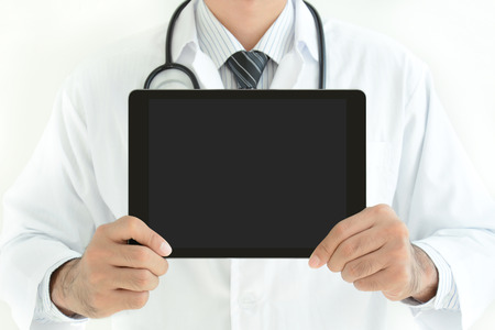 Doctor showing tablet pc with empty screen photo