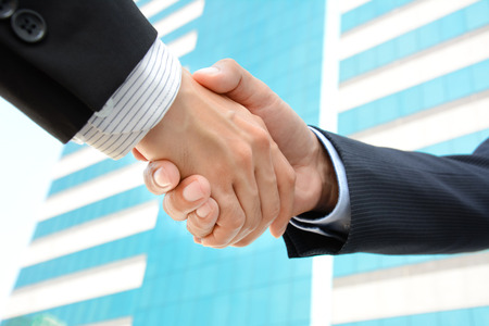 merger: Handshake of businessmen - greeting , dealing, merger & acquisition concepts