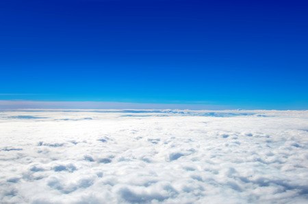 on cloud nine: Clear blue sky above cloud layer - soft focus
