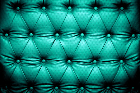 buttoned: Blue turquoise leather texture background with buttoned pattern