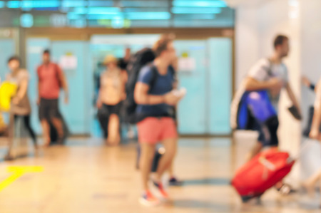 arrive: Blurred image of people as arrival passengers at the airport terminal