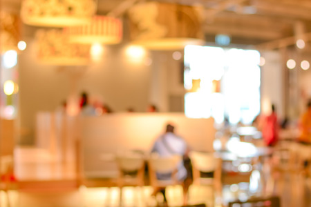 gaussian: Blurred restaurant interior with people -can be used as background