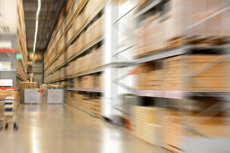 storehouse: Fast moving motion blur of warehouse or storehouse as background