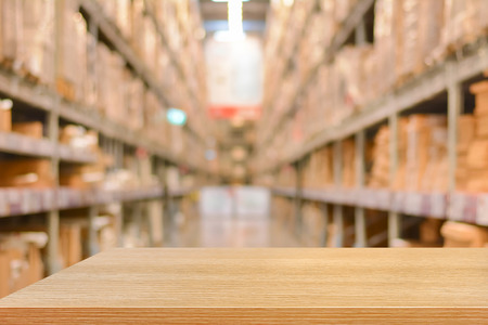 gaussian distribution: Empty wood table top or shelf on blurred warehouse background - can montage or display your products