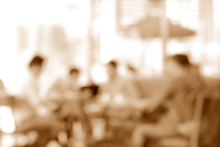 gaussian: Blurred image of people sitting in coffee shop, sepia tone - can be used as background