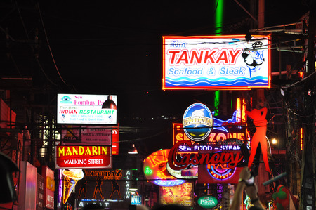 brothel: Pattaya, Thailand - Dec 31, 2013 : colorful neon signs of restaurants, pubs and bars at Pattaya night walking street, Thailand Editorial