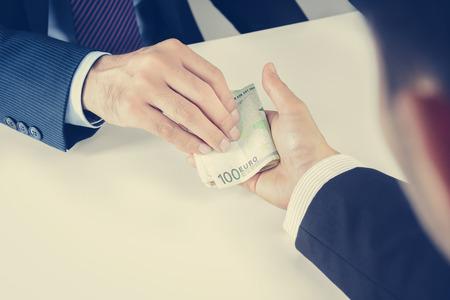 eur: Businessman hands passing money, Euro currency (EUR), bribery concept - vintage tone