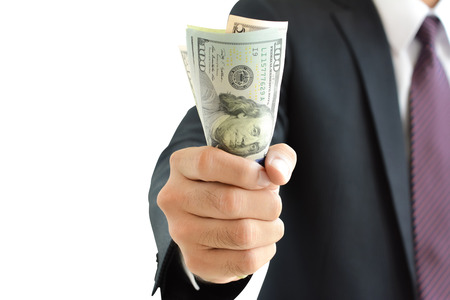 grabbing hand: Businessman hand grabbing money, US dollar (USD) bills