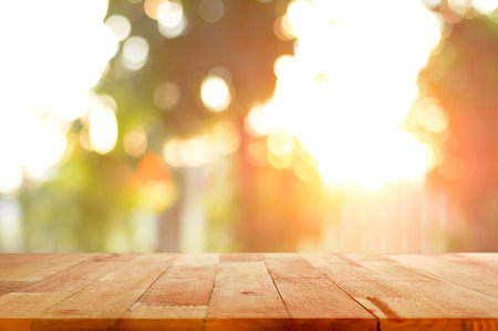 defocused: Wood table top on shiny sunlight bokeh background - can used for display or montage your products