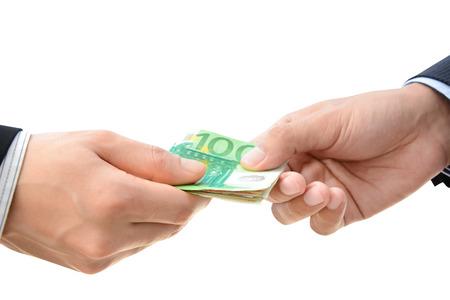 Hands passing money - Euro (EUR) bills Stock Photo